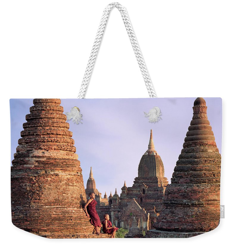 Child Weekender Tote Bag featuring the photograph Myanmar, Bagan, Buddhist Monks On Temple by Martin Puddy