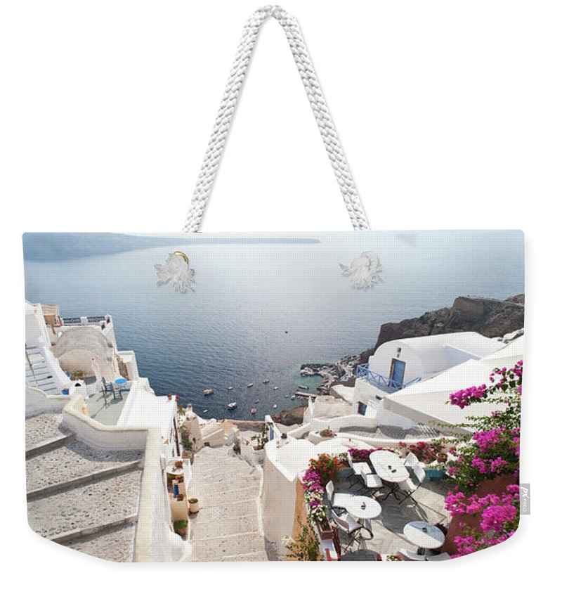 Greek Culture Weekender Tote Bag featuring the photograph Oia In Santorini, Greece by David Clapp