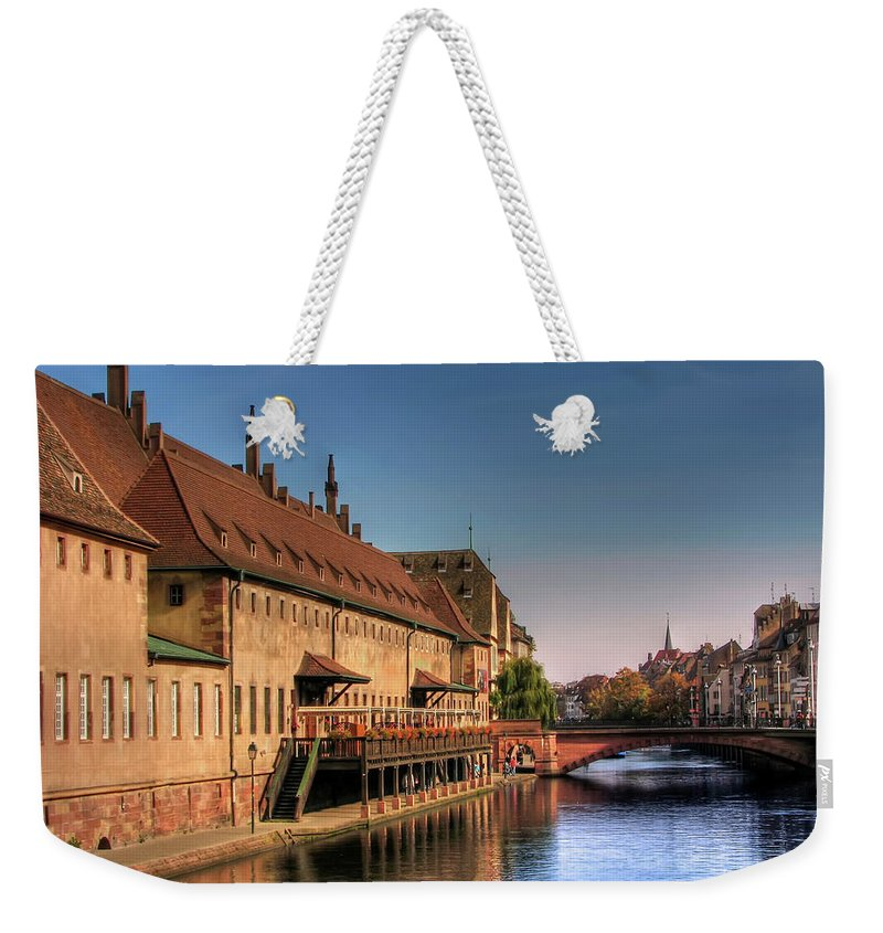Clear Sky Weekender Tote Bag featuring the photograph Strasbourg River by Michael Kitromilides