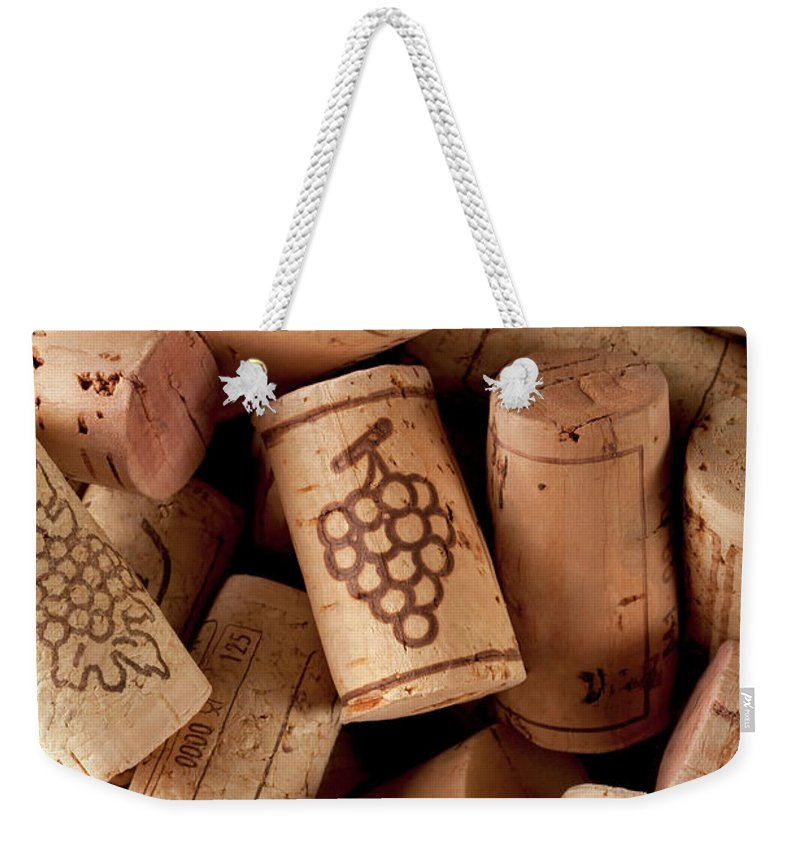 Alcohol Weekender Tote Bag featuring the photograph Wine Corks by Malerapaso