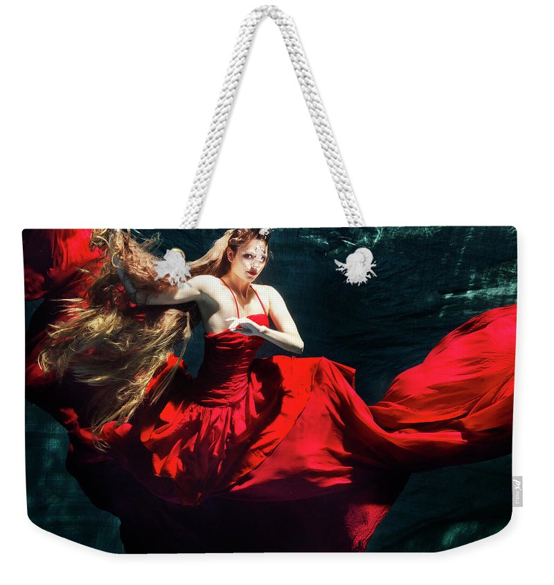 Ballet Dancer Weekender Tote Bag featuring the photograph Female Dancer Performing Under Water by Henrik Sorensen