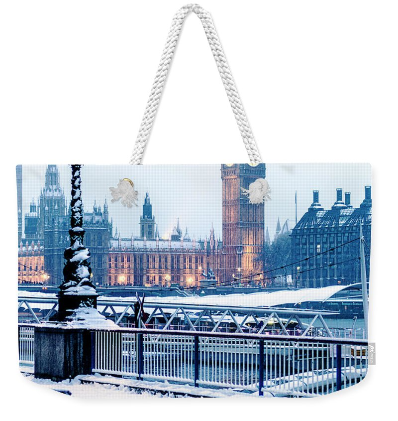 Clock Tower Weekender Tote Bag featuring the photograph Houses Of Parliament In The Snow by Doug Armand