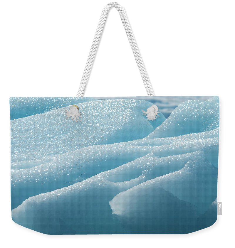 Melting Weekender Tote Bag featuring the photograph Iceberg Along The Antarctic Peninsula by Mint Images - David Schultz