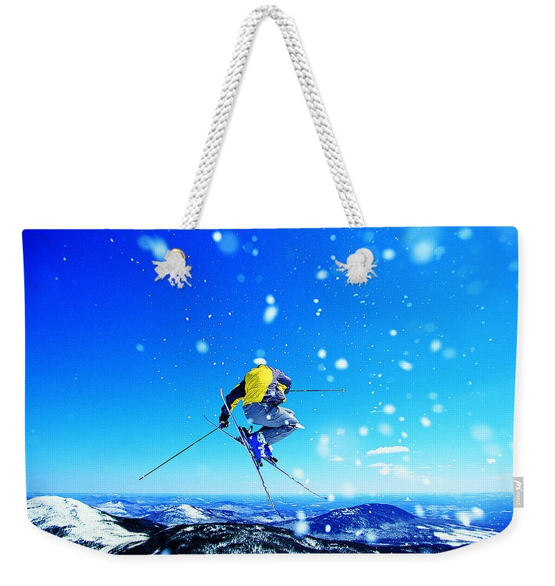 Skiing Weekender Tote Bag featuring the photograph Man Skiing by Digital Vision.
