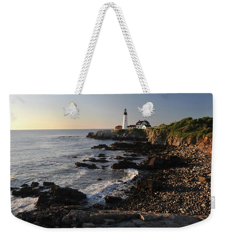 Water's Edge Weekender Tote Bag featuring the photograph Portland Head Light by Aimintang