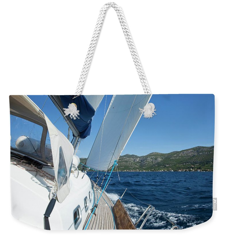 Curve Weekender Tote Bag featuring the photograph Sailing In The Wind With Sailboat by Mbbirdy