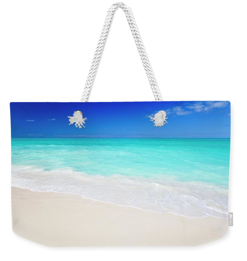 Water's Edge Weekender Tote Bag featuring the photograph Clean White Caribbean Beach With Blue by Michaelutech