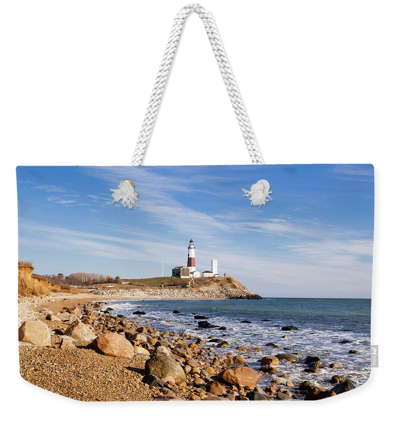 Headland Weekender Tote Bag featuring the photograph Lighthouse At Montauk Point, Long by Alex Potemkin