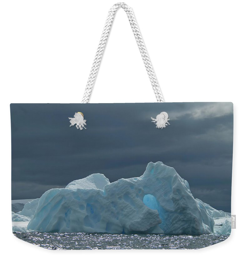 Iceberg Weekender Tote Bag featuring the photograph Iceberg Along The Antarctic Peninsula by Mint Images - David Schultz