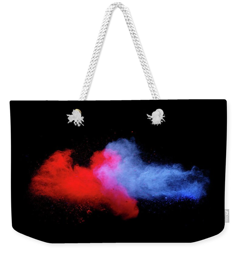 Copenhagen Weekender Tote Bag featuring the photograph Explosion Of Colored Powder by Henrik Sorensen