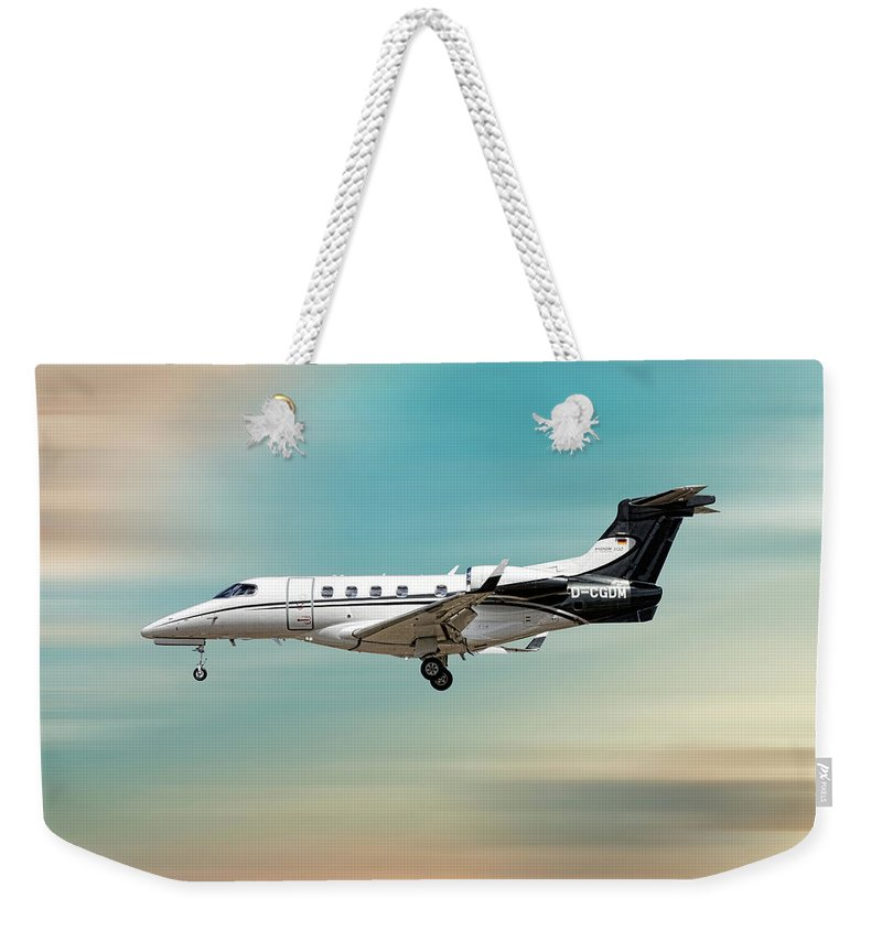 Phenom Weekender Tote Bag featuring the mixed media Phenom 300 Arrow by Smart Aviation