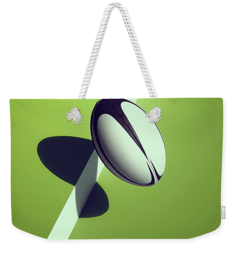 Newcraft Weekender Tote Bag featuring the photograph Sports Shadow by Kelvin Murray