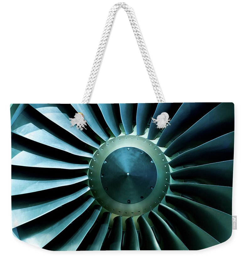 Material Weekender Tote Bag featuring the photograph A Close Of Up A Turbine Showing The by Brasil2