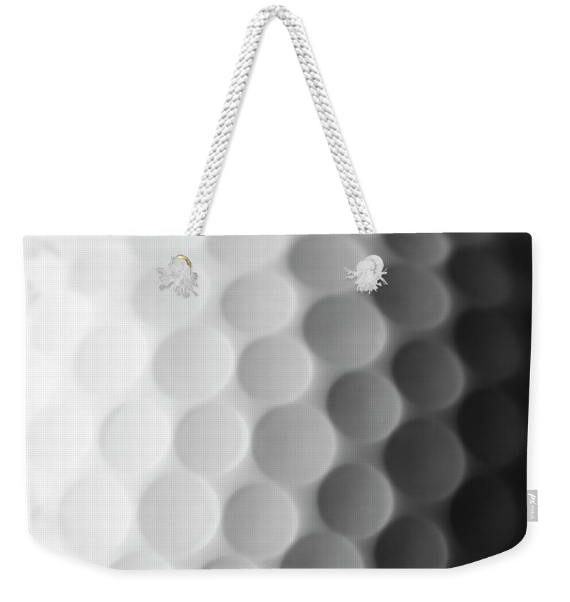 Ball Weekender Tote Bag featuring the photograph A Close Up Shot Of A Golf Ball, White by Anthiacumming