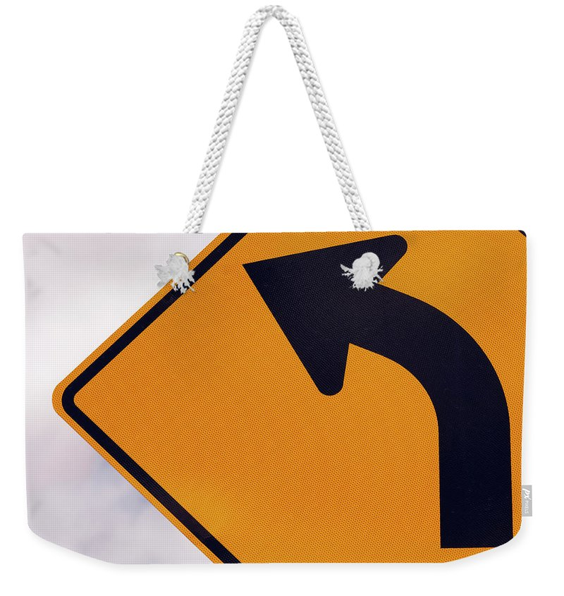 Curve Weekender Tote Bag featuring the photograph A Curve Ahead Road Sign Warning by Martin Ruegner