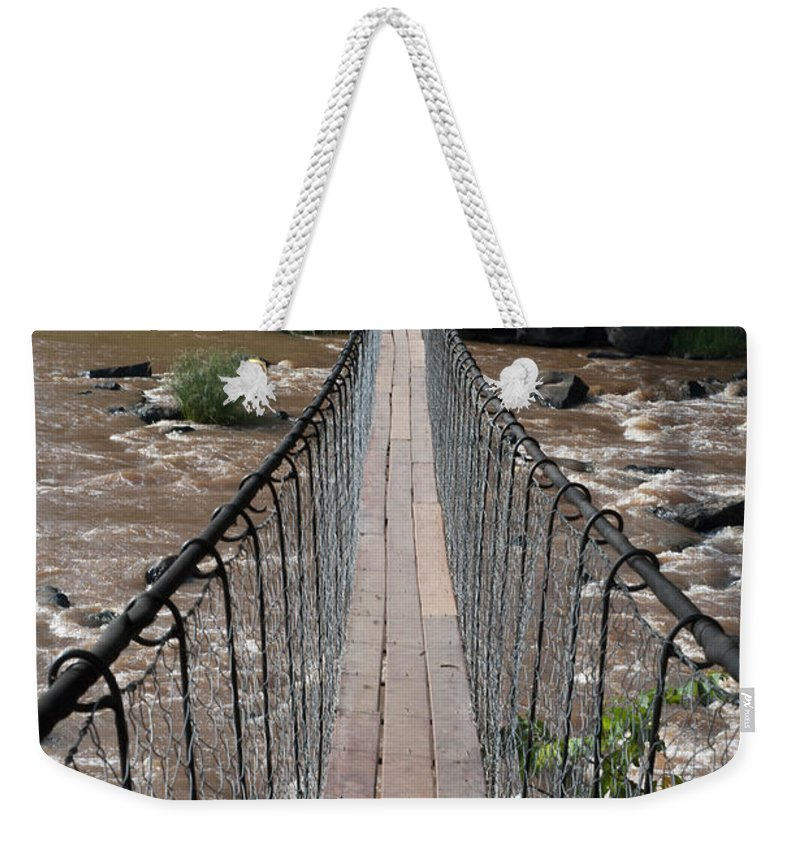 Long Weekender Tote Bag featuring the photograph A Long Suspension Bridge Over A River by Diane Levit / Design Pics