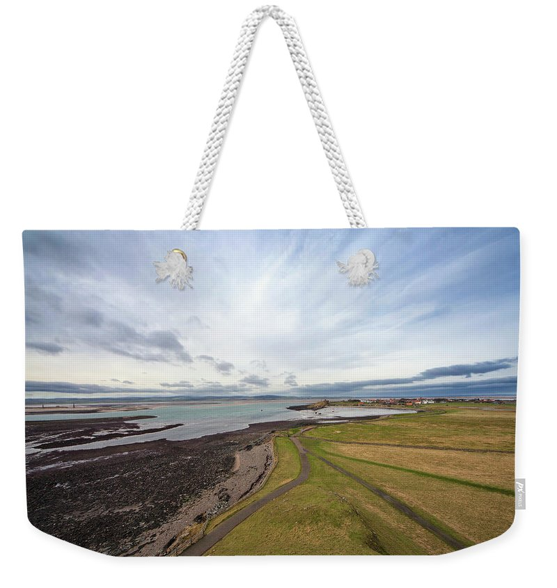 Grass Weekender Tote Bag featuring the photograph A Road Running Along The Coast by John Short / Design Pics