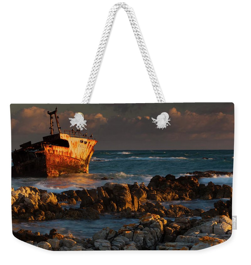 Non-urban Scene Weekender Tote Bag featuring the photograph A Rusting Wreck, An Abandoned Ship Off by Mint Images - Art Wolfe