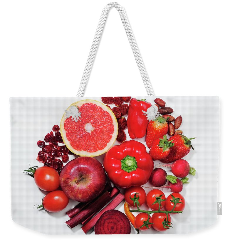 White Background Weekender Tote Bag featuring the photograph A Selection Of Red Fruits & Vegetables by David Malan