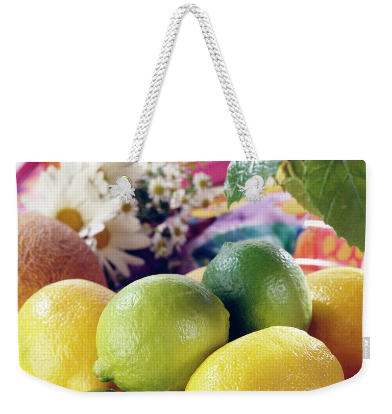 Close-up Weekender Tote Bag featuring the photograph A Summer Table Setting With Lemons And by Steve Wisbauer