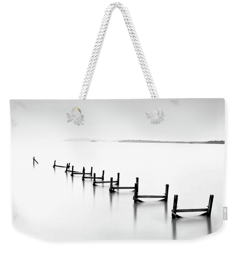 Tranquility Weekender Tote Bag featuring the photograph Abandond Jetty by Photography By Azrudin