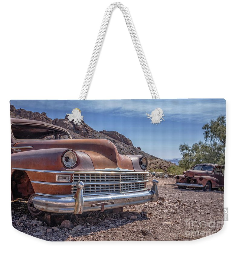 Cars Weekender Tote Bag featuring the photograph Abandoned Cars In The Desert by Edward Fielding