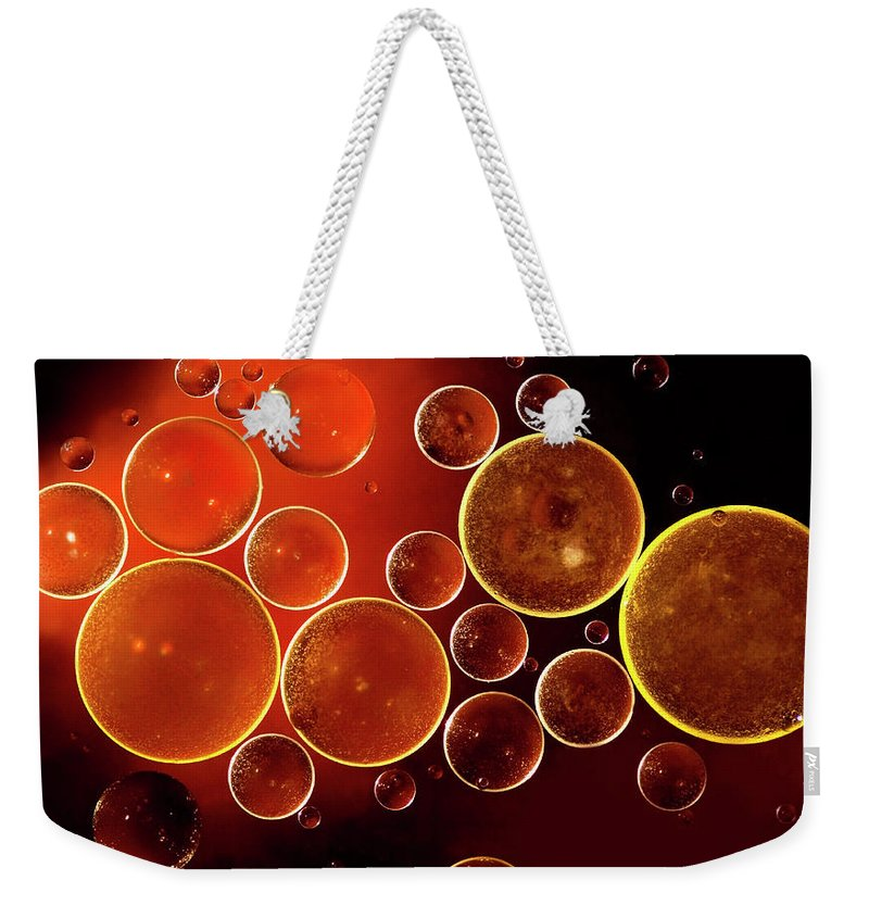 Black Color Weekender Tote Bag featuring the photograph Abstract Red Bubbles by Zeljkosantrac