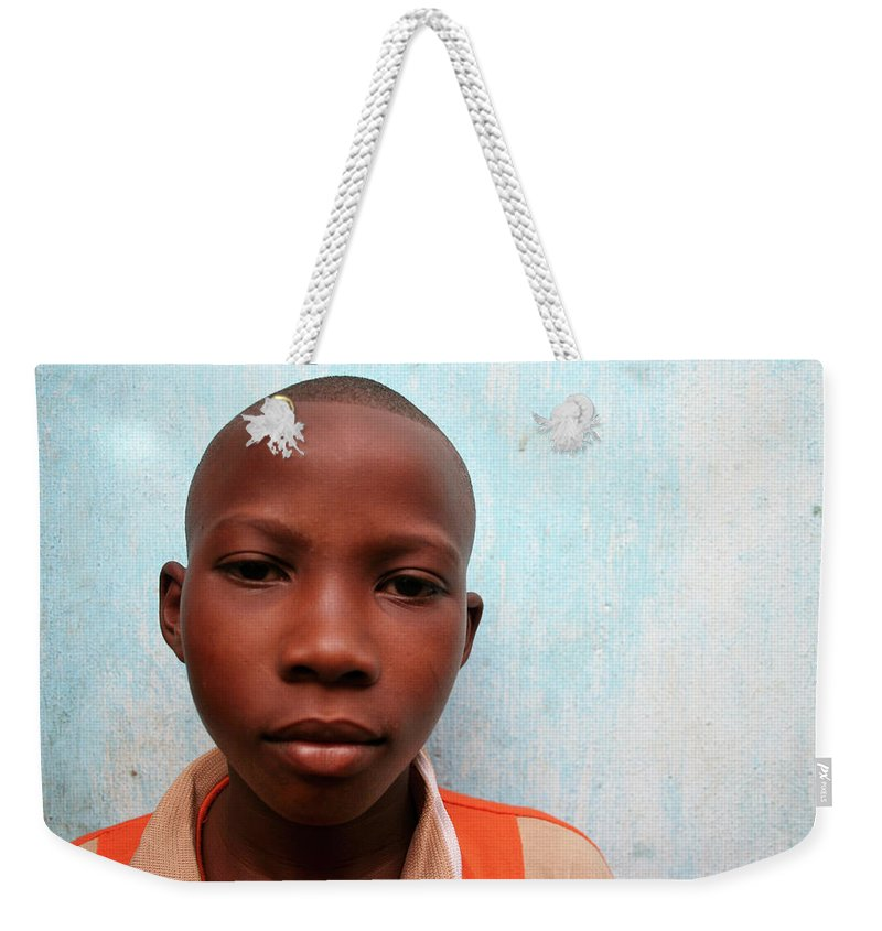 Education Weekender Tote Bag featuring the photograph African Boy by Peeterv