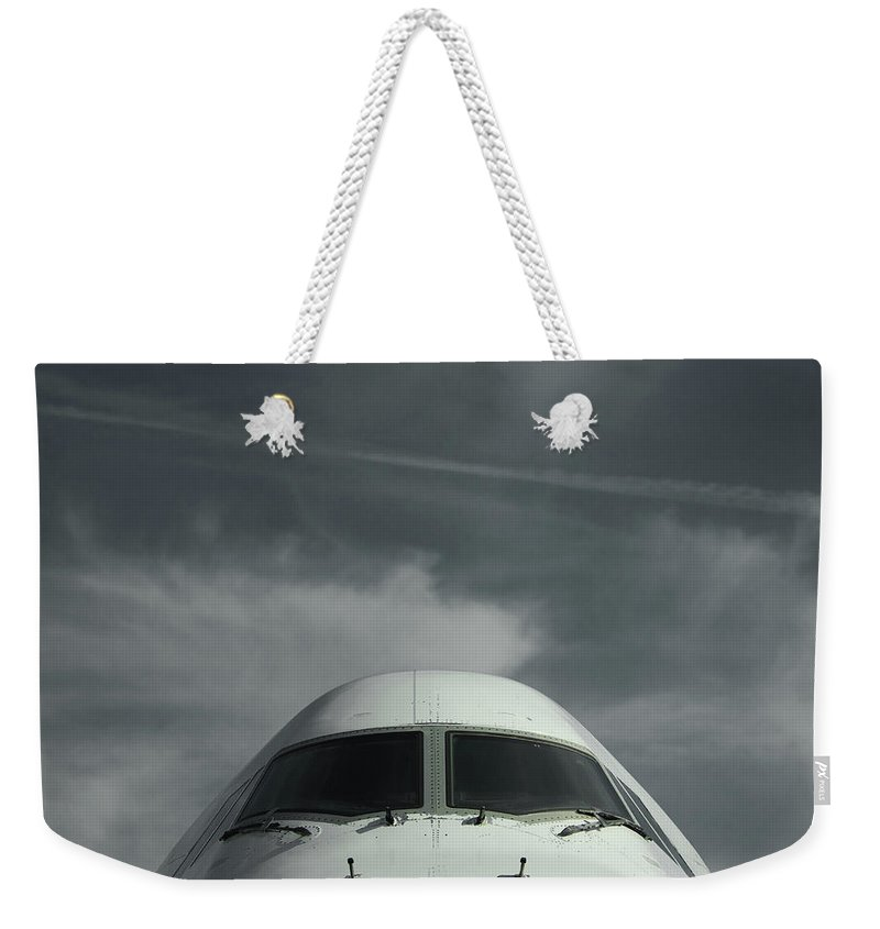 Tranquility Weekender Tote Bag featuring the photograph Aircraft by Laurent Chantegros