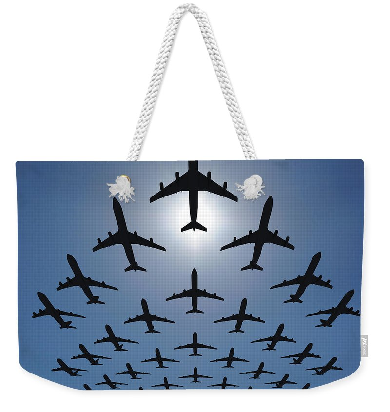 Expertise Weekender Tote Bag featuring the photograph Airplane Silhouettes Fly In V Formation by Georgo