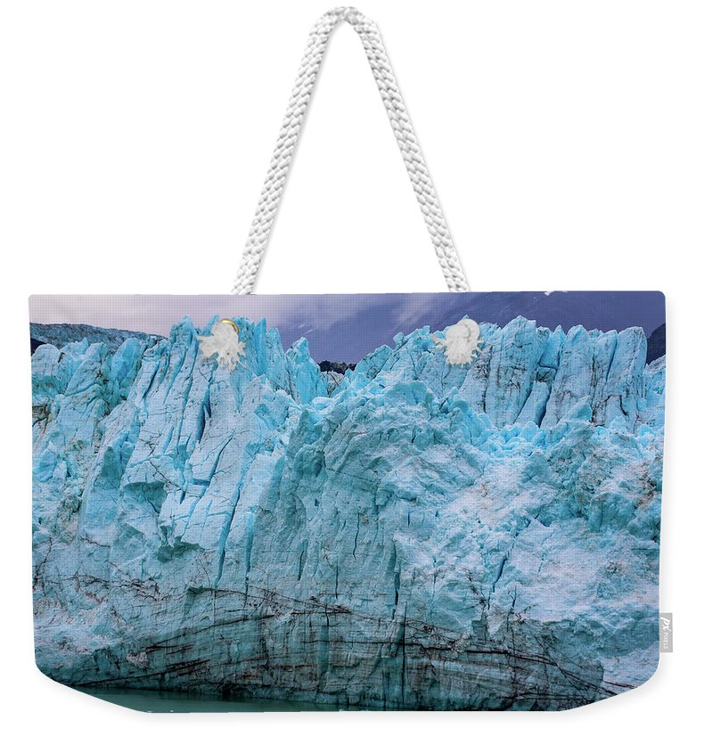 Alaska Weekender Tote Bag featuring the photograph Alaskan Blue Glacier Ice by Anthony Jones