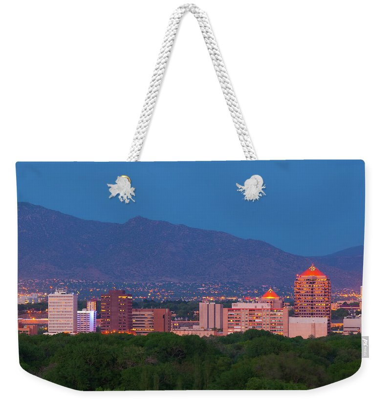 Downtown District Weekender Tote Bag featuring the photograph Albuquerque Skyline At Dusk by Davel5957