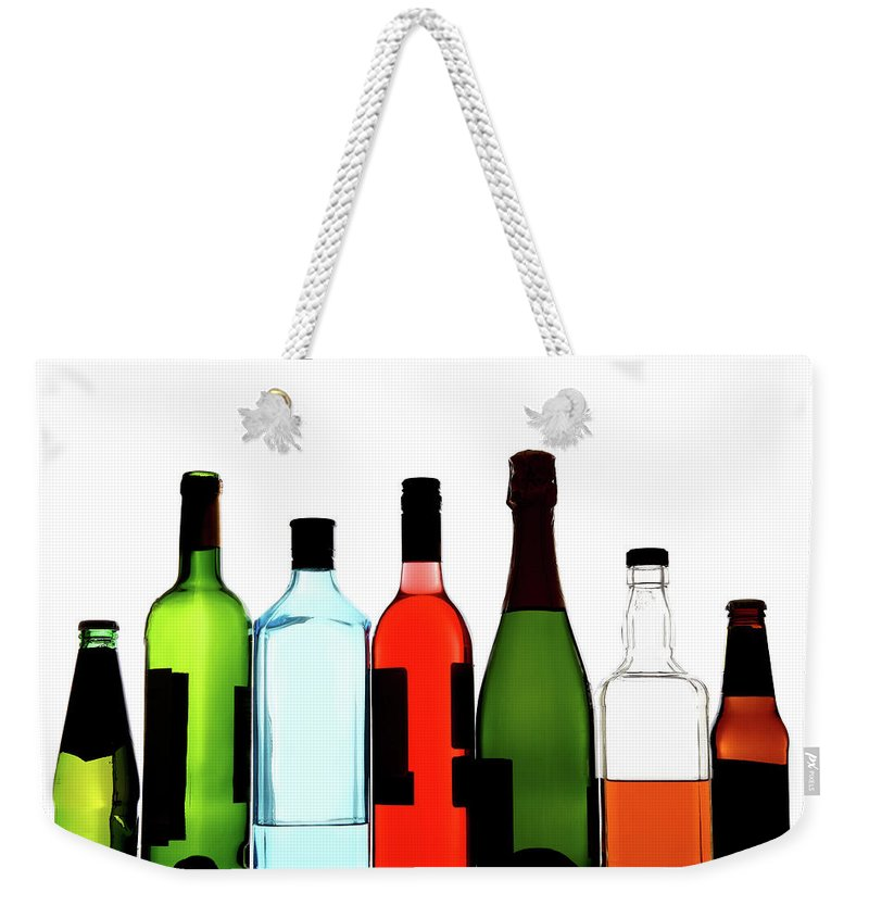 Alcohol Weekender Tote Bag featuring the photograph Alcohol by Mattjeacock