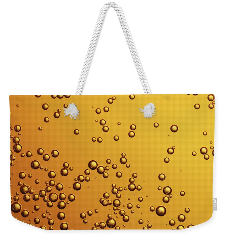 Alcohol Weekender Tote Bag featuring the photograph Amber Colored Carbonated Bubbles by Burwellphotography