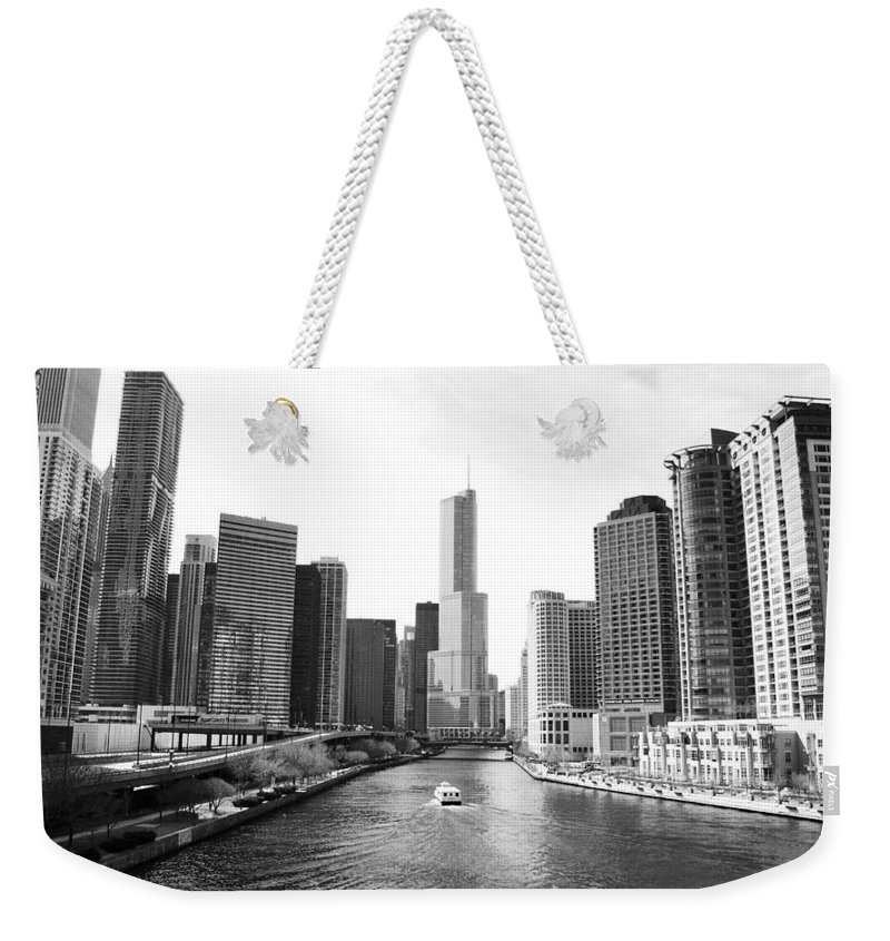 Chicago River Weekender Tote Bag featuring the photograph An Unknown Skyline Along The Chicago by Ricardo Montiel