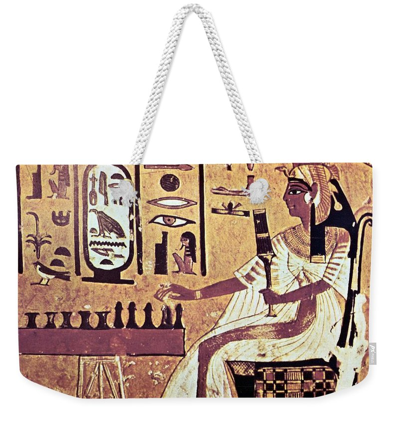 Human Representation Weekender Tote Bag featuring the photograph Ancient Egyptian Queen Nefetari Playing by Photos.com