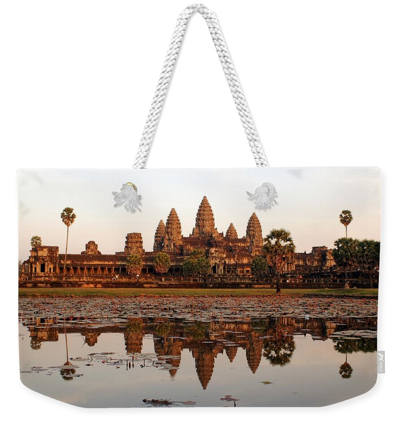 Tranquility Weekender Tote Bag featuring the photograph Angkor Wat - Siem Reap - Cambodia by By Lionel Arnould