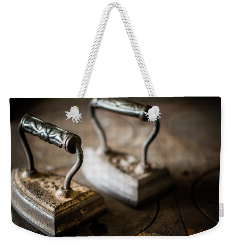 Two Objects Weekender Tote Bag featuring the photograph Antique Irons by Jimss