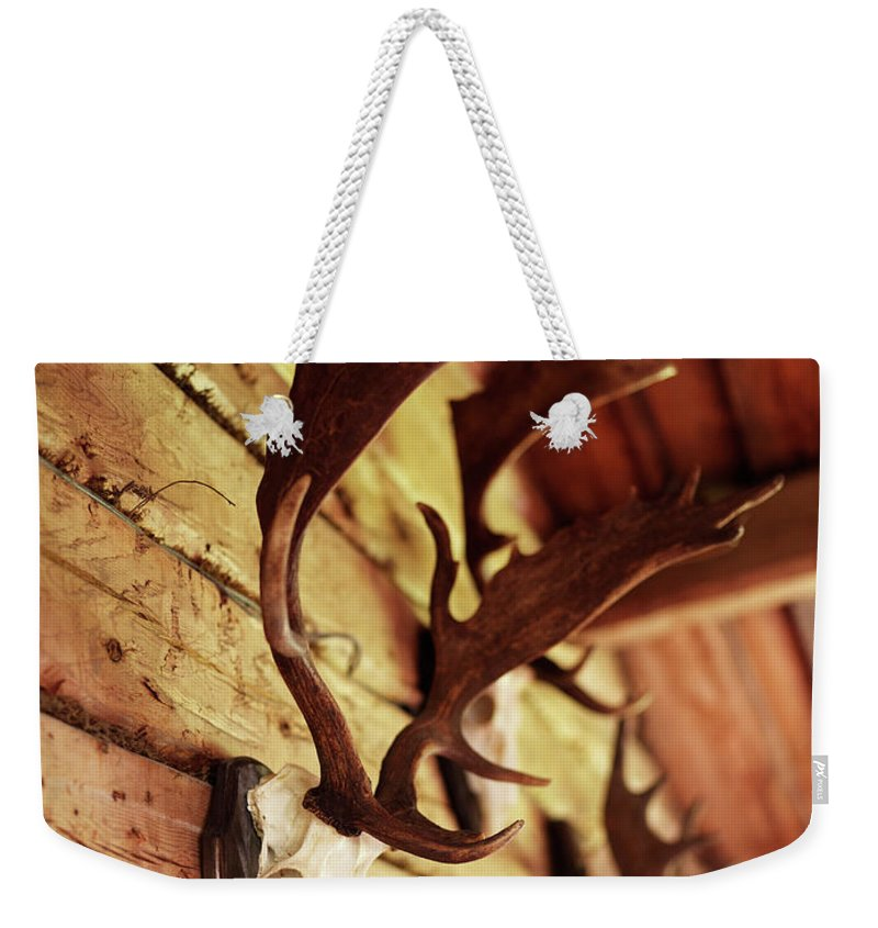 Horned Weekender Tote Bag featuring the photograph Antler Collection On Wall by Granefelt, Lena