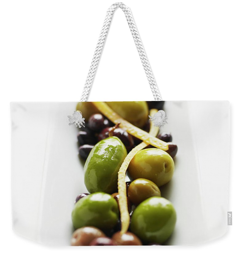 White Background Weekender Tote Bag featuring the photograph Appetizer Of Warm Marinated Olives by Thomas Barwick
