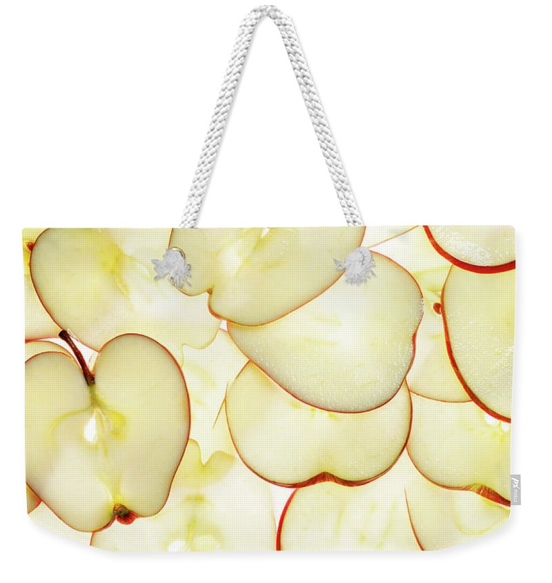 Large Group Of Objects Weekender Tote Bag featuring the photograph Apple Slices by Lauren Burke