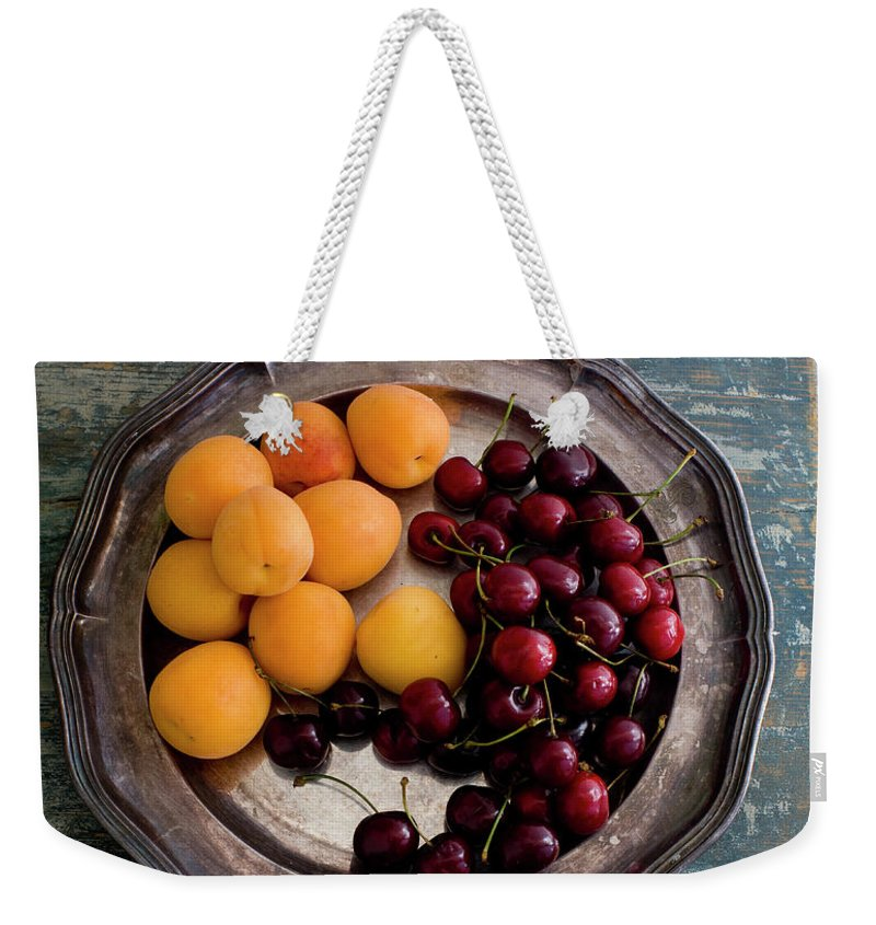Tranquility Weekender Tote Bag featuring the photograph Apricots And Cherries On Silver Tray by Bjurling, Hans