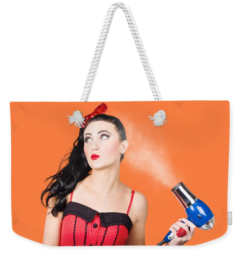Hairdryer Weekender Tote Bag featuring the photograph Attractive Brunette Girl Dressed In Red by Jorgo Photography - Wall Art Gallery