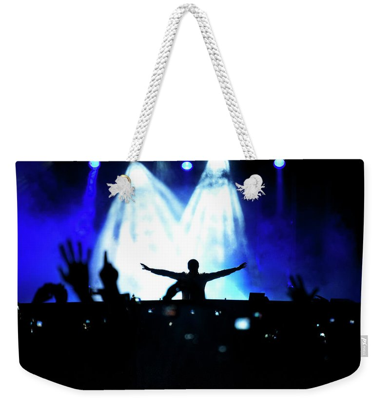 Rock Music Weekender Tote Bag featuring the photograph Audience At A Rock Concert by Win-initiative
