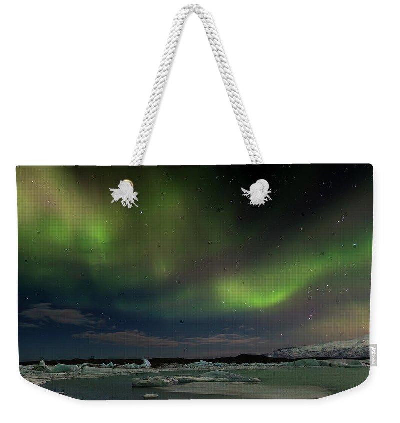 Scenics Weekender Tote Bag featuring the photograph Auroras En Jokulsarlon Islandia by Martin Zalba