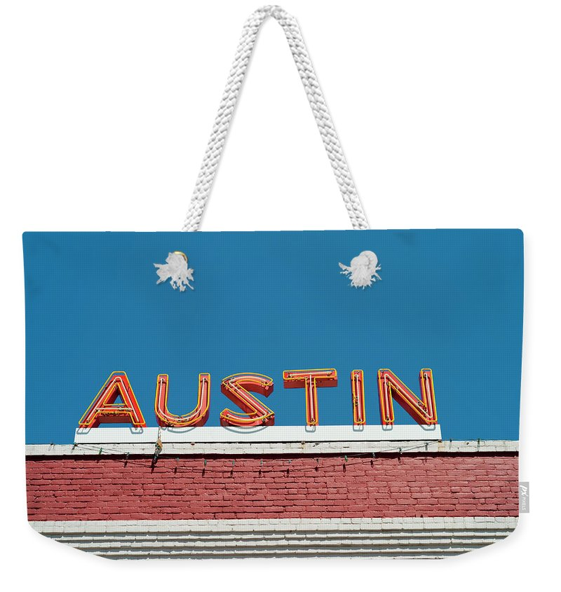 Sunlight Weekender Tote Bag featuring the photograph Austin Neon Sign by Austinartist
