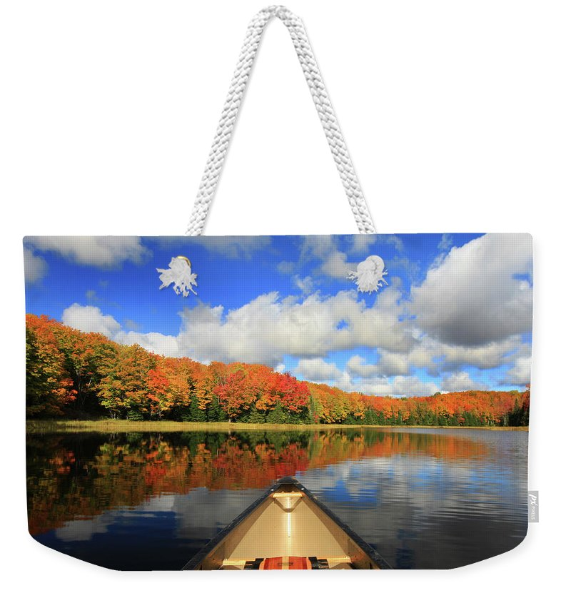 Scenics Weekender Tote Bag featuring the photograph Autumn In A Canoe by Photos By Michael Crowley