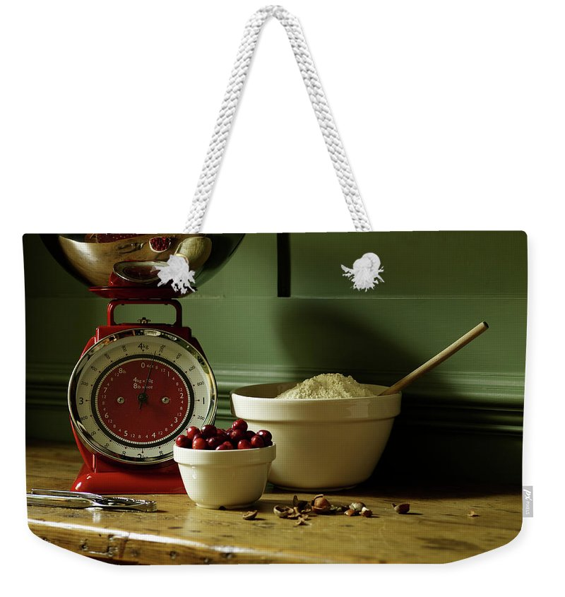 Nut Weekender Tote Bag featuring the photograph Baking Ingredients Sit On Table by Max Oppenheim