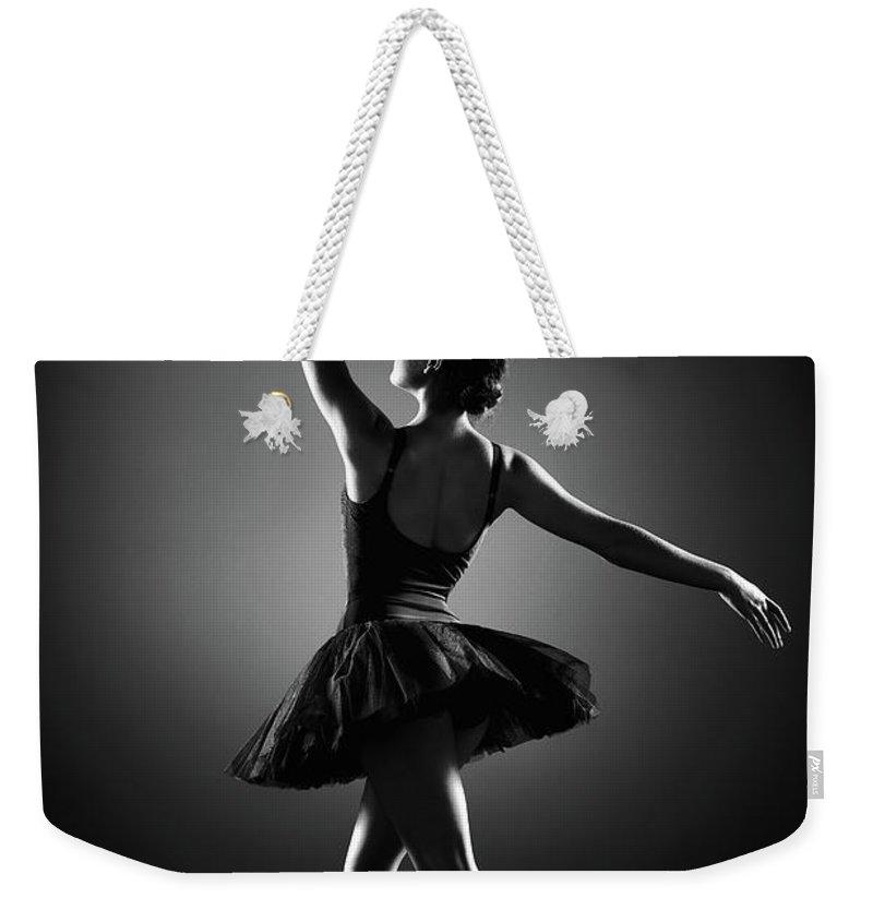 Ballerina Weekender Tote Bag featuring the photograph Ballerina Dancing by Johan Swanepoel