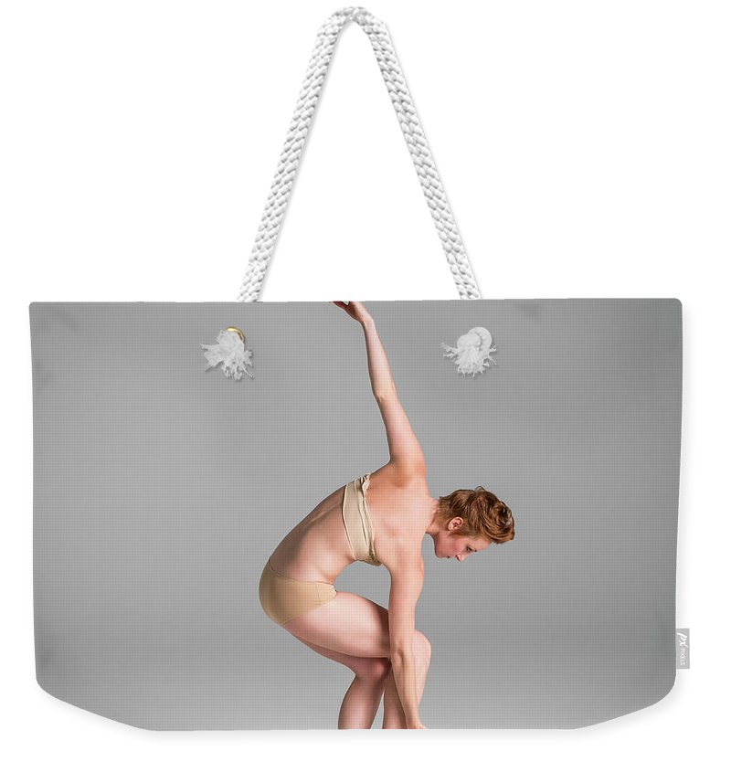 Ballet Dancer Weekender Tote Bag featuring the photograph Ballerina In Studio Dancing by Nisian Hughes